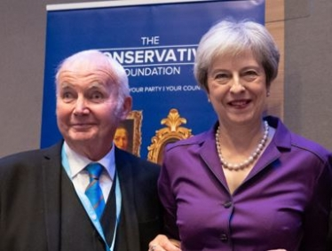 Philip Martin with the Prime Minister Theresa May